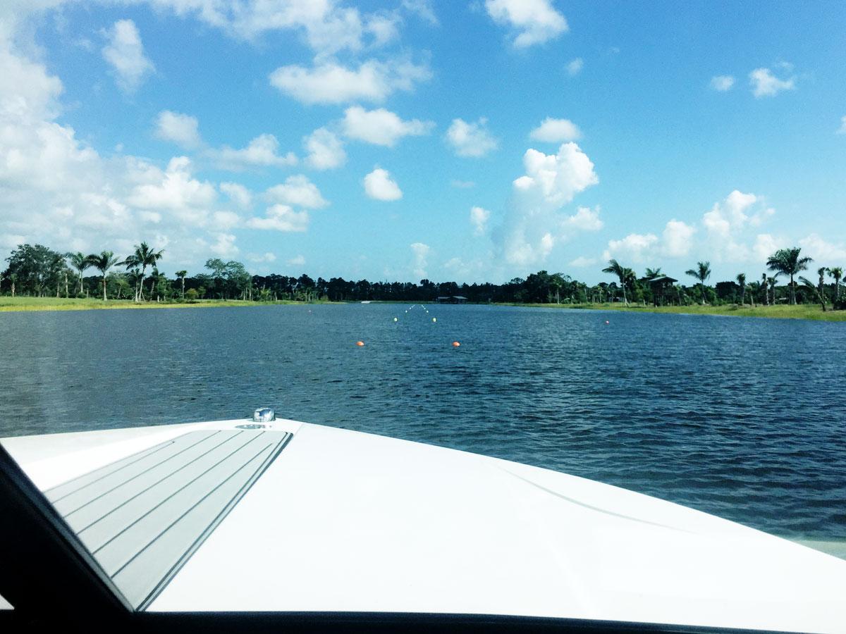 blue sky, puffy clouds over ski boat